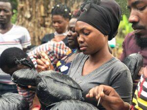 Women in Uganda preparing her mushroom starter kit